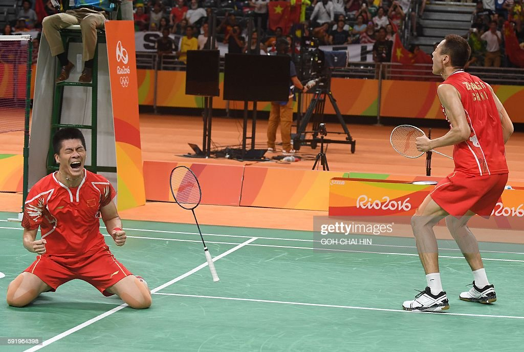 China's Zhang Nan (R) and China's Fu Haifeng react after winning against Malaysia's V Shem Goh and Malaysia's Wee Kiong Tan during their men's doubles Gold Medal badminton match at the Riocentro stadium in Rio de Janeiro on August 19, 2016, for the Rio 2016 Olympic Games. China's Zhang Nan and China's Fu Haifeng won the match. / AFP / GOH Chai Hin