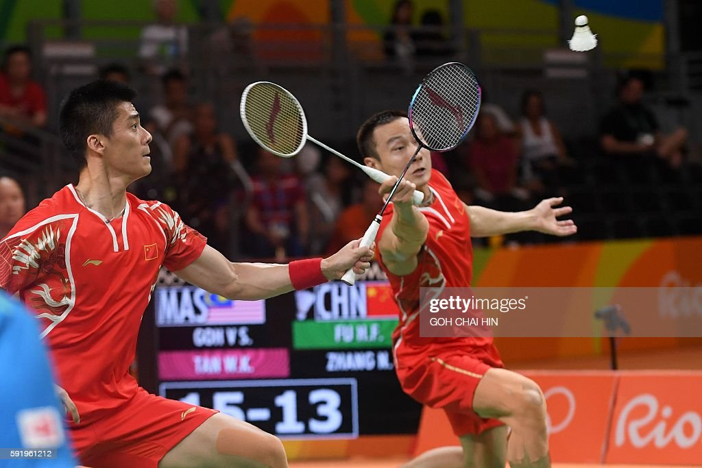 China's Zhang Nan (R) and China's Fu Haifeng return against Malaysia's V Shem Goh and Malaysia's Wee Kiong Tan during their men's doubles Gold Medal badminton match at the Riocentro stadium in Rio de Janeiro on August 19, 2016, for the Rio 2016 Olympic Games. / AFP / GOH Chai Hin