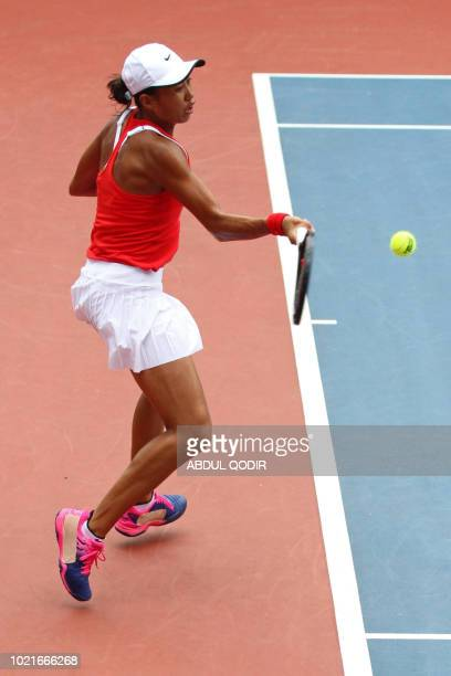 China's Zhang Shuai hits a return against India's Ankita Ravinderkrishan Raina in their women's singles tennis semifinal match at the 2018 Asian...
