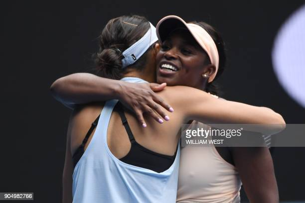 China's Zhang Shuai hugs Sloane Stephens of the US after winning their women's singles first round match on day one of the Australian Open tennis...