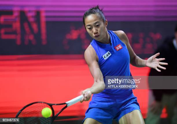 China's Zhang Shuai serves the ball to Belgium's Alison Van Uytvanck during their tennis match at the Hungarian Ladies Open on February 23 2018 in...