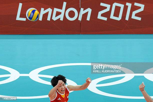 China's Zhang Xian celebrates her team's victory in the Women's Preliminary Pool B volleyball Match between China and Turkey in the 2012 London...