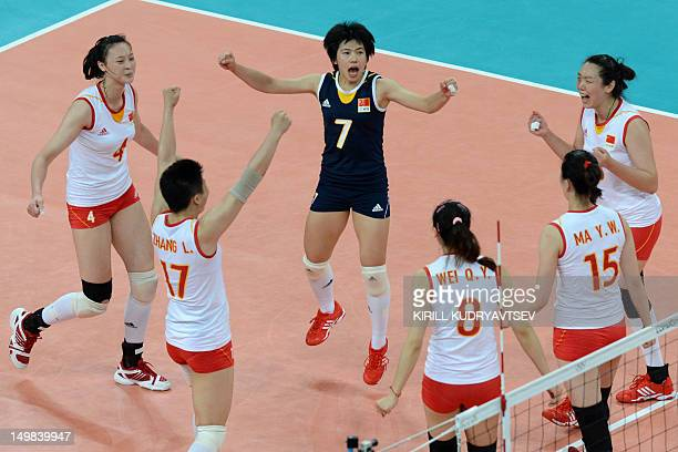 China's Zhang Xian Ma Yunwen Wei Qiuyue ZhangLei and Ruoqi Hui celebrate winning a point during the Women's preliminary pool B volleyball match...