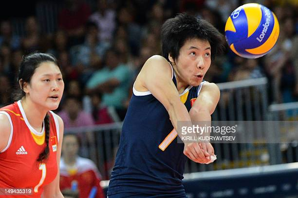 China's Zhang Xian sets during the women's volleyball match between Serbia and China for The 2012 London Olympic Games in London on July 28 2012 AFP...