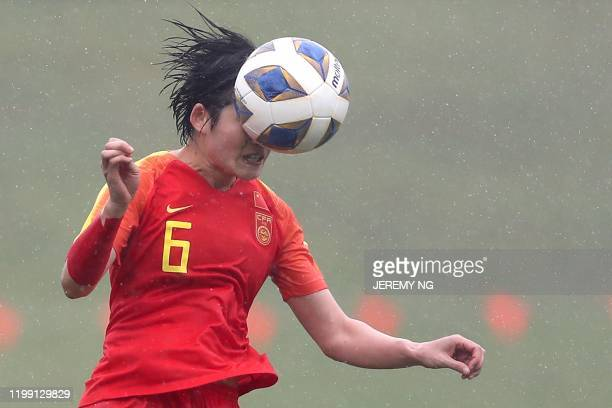Chinas Zhang Xin heads the ball during the women's Olympic football tournament qualifier match between China and Thailand at Campbelltown Stadium in...