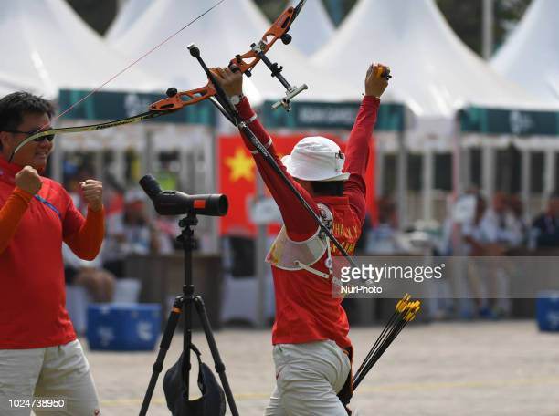 China's Zhang Xinyan celebrate a win with his coach on the Archery Recurve Women's Individual Final Asian Games 18th against Indonesia's Choirunisa...