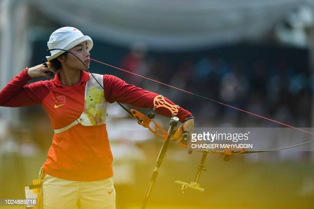 China's Zhang Xinyan competes in the archery recurve women's individual final round against Indonesia's Diananda Choirunisa at the 2018 Asian Games...