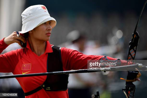 China's Zhang Xinyan competes in the recurve women's team bronze medal archery match between Japan and China at the 2018 Asian Games in Jakarta on...