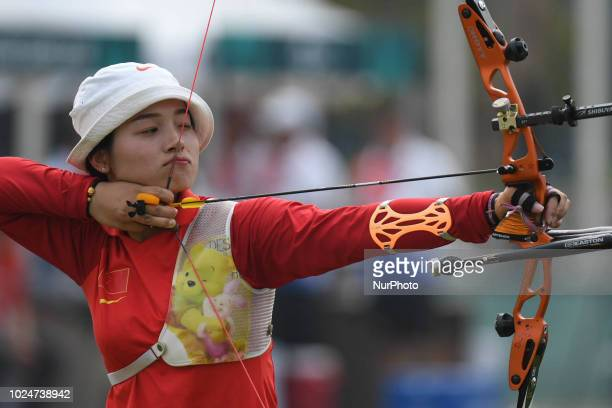 China's Zhang Xinyan in action on the Archery Recurve Women's Individual Final Asian Games 18th against Indonesia's Choirunisa Diananda at Archery...