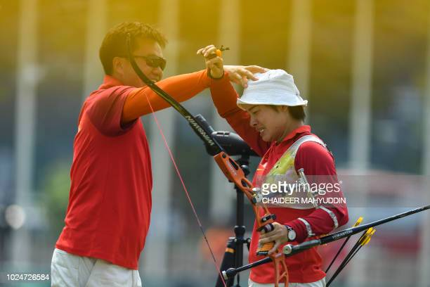China's Zhang Xinyan react as she competes in the archery recurve women's individual final round at the 2018 Asian Games in Jakarta on August 28 2018