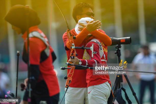 China's Zhang Xinyan reacts after winning gold in the archery recurve women's individual final rounds against Indonesia's Diananda Choirunisa at the...