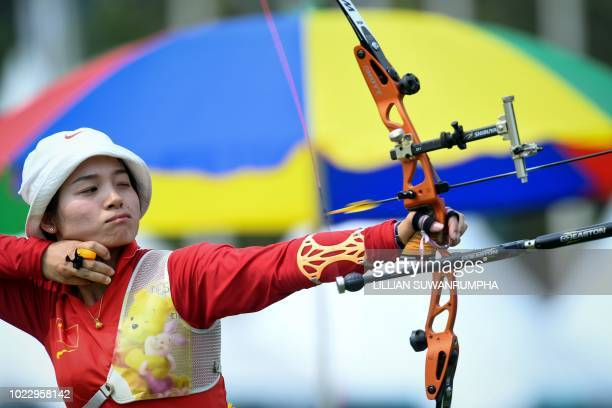 China's Zhang Xinyan releases an arrow during the recurve women's team quarterfinal round archery event at the 2018 Asian Games in Jakarta on August...