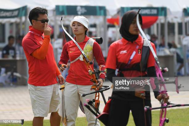 China's Zhang Xinyan with his coach during the Archery Recurve Women's Individual Final Asian Games 18th against Indonesia's Choirunisa Diananda at...