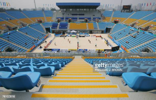 China's Zhang Ying and Ji Linjun play Indonesia's Yokbeth Kapasiang and Devota Rahawari in beach volleyball during a preOlympics test event at the...