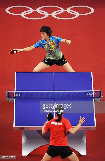 China's Zhang Yining plays against compatriot Wang Nan during their women's singles gold medal table tennis final at the 2008 Beijing Olympic Games...