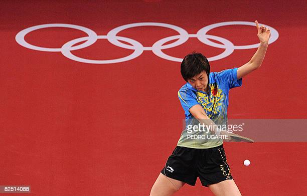China's Zhang Yining returns the ball to her compatriot Wang Nan during their women's singles gold medal table tennis final at the 2008 Beijing...