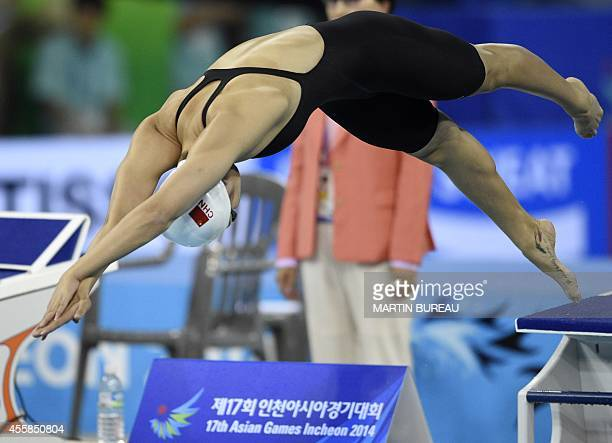 China's Zhang Yuhan competes in the final of the women's 400m freestyle swimming event during the 17th Asian Games at the Munhak Park Taehwan...