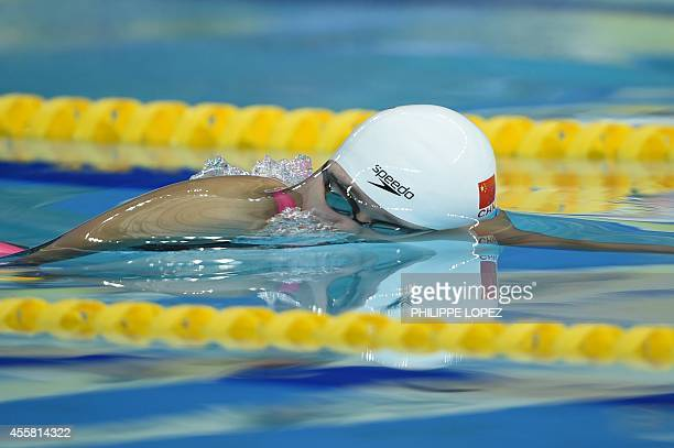 China's Zhang Yuhan competes in the heats of the women's 400m freestyle swimming event during the 17th Asian Games at the Munhak Park Taehwan...
