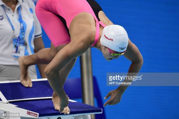 China's Zhang Yuhan dives at the start of a women's 400m freestyle heat during the swimming competition at the 2017 FINA World Championships in...