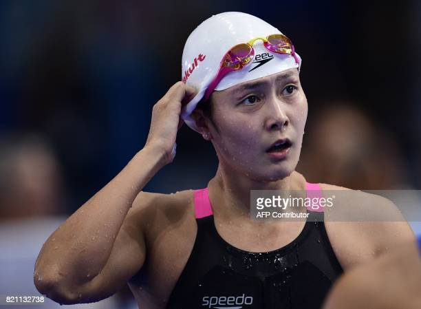 China's Zhang Yuhan reacts after competing in a women's 400m freestyle heat during the swimming competition at the 2017 FINA World Championships in...