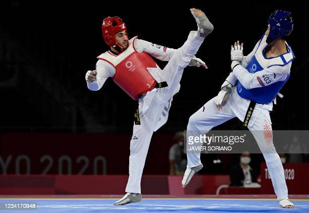 China's Zhao Shuai and Refugee Olympic Team's Abdullah Sediqi compete in the taekwondo men's -68kg elimination round bout during the Tokyo 2020...