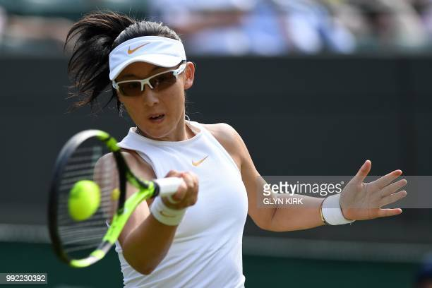 China's Zheng Saisai returns against Romania's Simona Halep during their women's singles second round match on the fourth day of the 2018 Wimbledon...