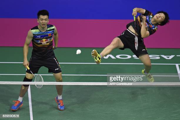 China's Zheng Siwei and Chen Qingchen return against England's Chris and Gabrielle Adcock during their semi-final mixed doubles match during the 2017...