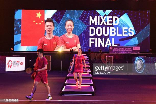 China's Zheng Siwei and Huang Yaqiong arrive for the mixed doubles final at the All England Open Badminton Championships in Birmingham central...