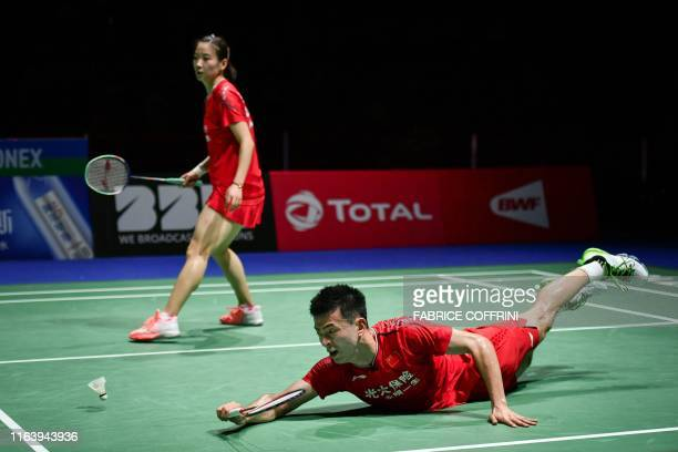 Chinas Zheng Siwei dives next to Chinas Huang Yaqiong during their mixed doubles final game against Thailand's Dechapol Puavaranukroh and Thailand's...