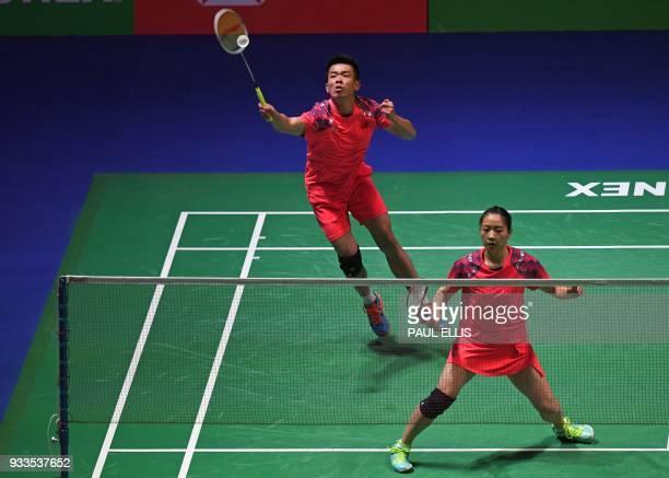 China's Zheng Siwei returns during the mixed doubles final match with China's Huang Yaqiong against Japan's Yuta Watanabe and Japan's Arisa Higashino...