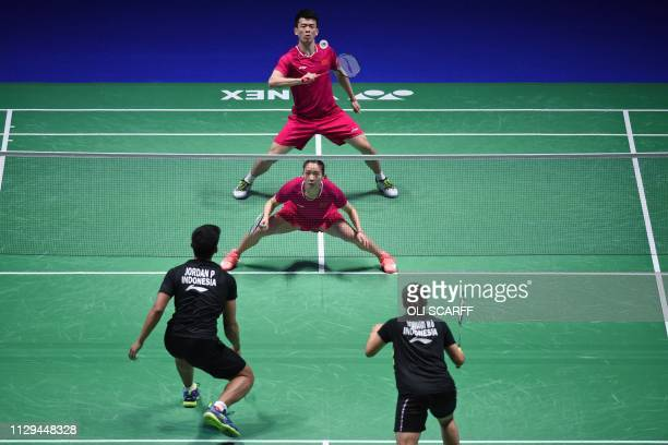 China's Zheng Siwei returns with Huang Yaqiong against Indonesia's Praveen Jordan and Melati Daeva Oktavianti in the mixed doubles semi final of the...
