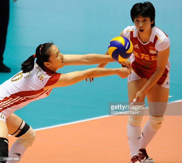 China's Zhou Suhong receives the ball while her teammate Zhang Xian looks on during their Pool E second round match aginst Japan at the World Women's...
