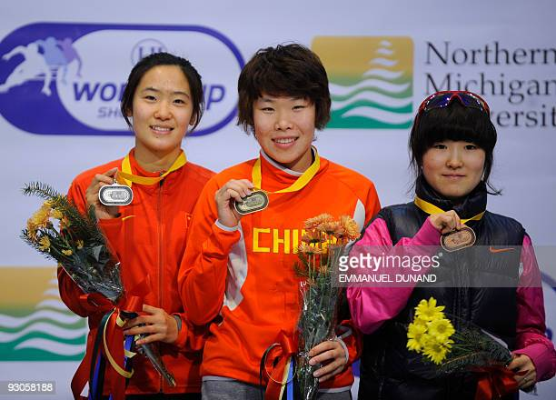 China's Zhou Yang with gold China's Liu Qiuhong with silver and South Korea's Lee EunByul with bronze celebrate on the winners' podium of the women's...