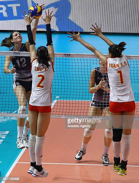 China's Zhu and Yuan in action against USA's Murphy during the FIVB Women's World Championship final match between China and USA at the Mediolanum...