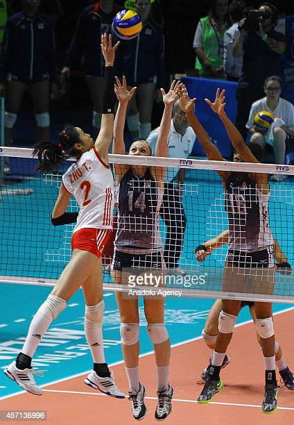 China's Zhu in action against USA's Akinradewo and Fawcett during the FIVB Women's World Championship final match between China and USA at the...