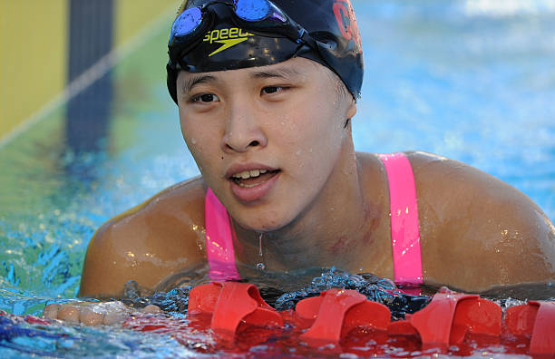 China's Zhu Menghui finishes the women's 100m freestyle ...