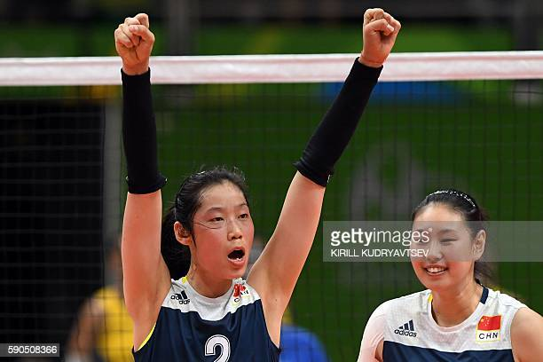 China's Zhu Ting and China's Yan Ni celebrate a point during the women's quarterfinal volleyball match between Brazil and China at the Maracanazinho...