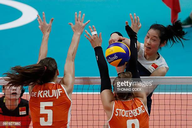 China's Zhu Ting spikes the ball during the women's semifinal volleyball match between China and the Netherlands at Maracanazinho Stadium in Rio de...
