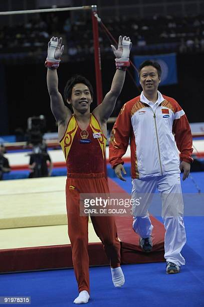 China's Zou Kai celebrates after performing in the high bar event in the apparatus finals during the Artistic Gymnastics World Championships 2009 at...