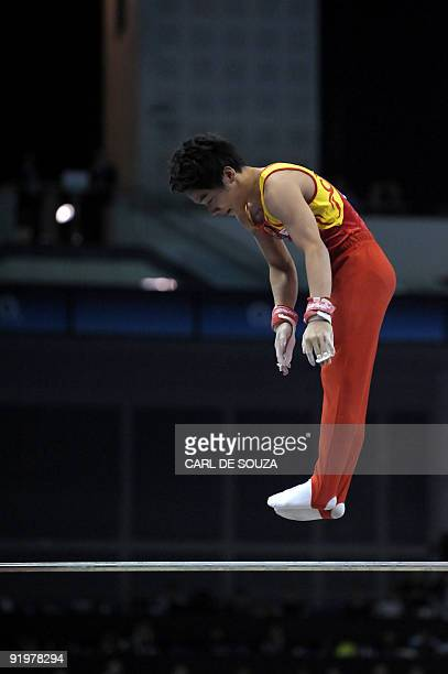 China's Zou Kai performs in the high bar event in the apparatus finals during the Artistic Gymnastics World Championships 2009 at the 02 Arena in...