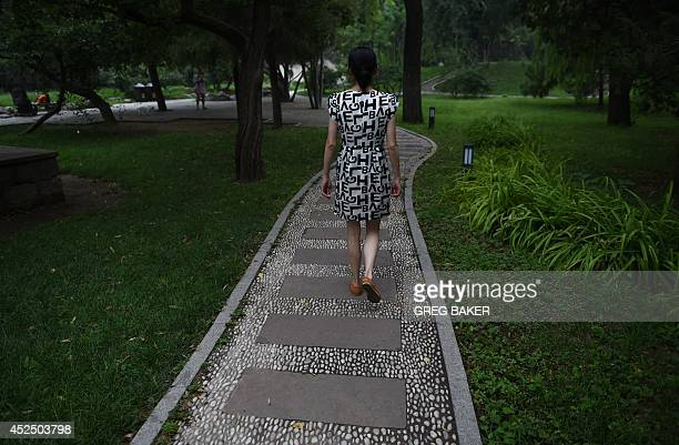 ChinasocialwomencrimeFEATURE by Felicia Sonmez This photo taken on July 17 2014 shows Ma Shuyun as she walks through a park in Beijing For more than...