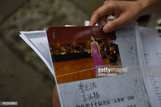 ChinasocialwomencrimeFEATURE by Felicia Sonmez This photo taken on July 17 2014 shows Ma Shuyun holding a photo of herself at an amateur ballroom...