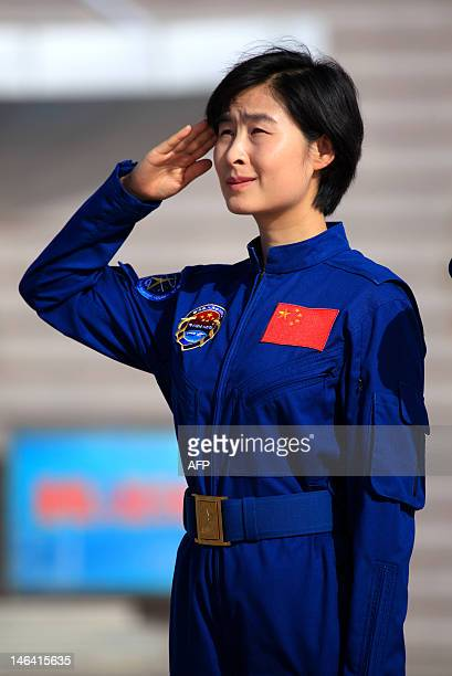STORY 'ChinaspacewomanLiuPROFILE' This picture taken on June 10 2012 shows China's first female astronaut Liu Yang salutes during a ceremony at the...
