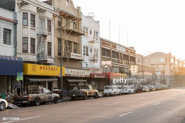 chinatown business at dusk - oakland california stock pictures, royalty-free photos & images