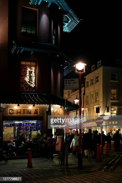 chinatown by night in london - gwengoat stock pictures, royalty-free photos & images