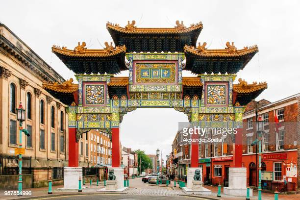 chinatown district in liverpool, england, uk - arch architectural feature stock pictures, royalty-free photos & images