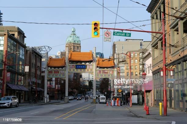chinatown gate at vancouver, british columbia - 中華街 ストックフォトと画像