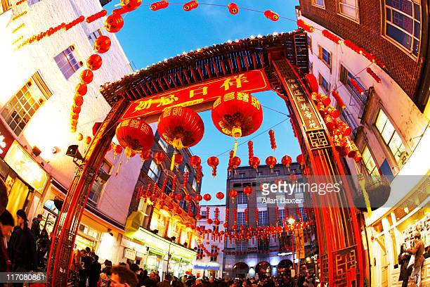 chinatown in london at dusk - chinatown stock photos and pictures