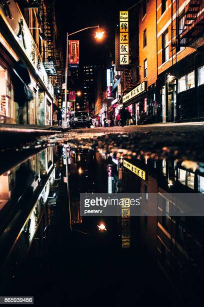 chinatown reflections, new york city - chinatown stock photos and pictures