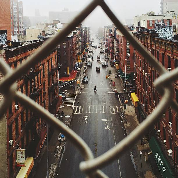 Chinatown Seen Through Fence On A Foggy Day, NYC Wall Art